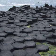 Columnar Basalts are rock formations resulting from the sudden cooling of lava flow. These are formed in a random cellular network though the equally distributed sides is six, giving the hexagonal structures as it is man made Hexagonal shape. It is a dark black or grey colored rock, having silica and comparatively rich in iron and magnesium.