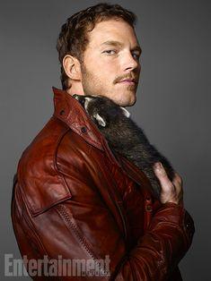 Chris Pratt with a raccoon