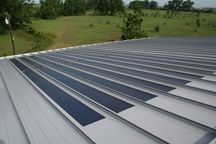 Tin roof application. Hurricane? Whirlwind Solar Energy Systems is an amorphous BIPV (Building Integrated PhotoVoltaic) that is installed directly onto our standing seam roof panels in our manufacturing facility by experienced trained individuals, eliminating the need for any penetration through the roof panel making it safe, sound, and stable. It is also known as a Laminate Solar Panel or a Peel and Stick Solar Panel. Tiny house living --Shared by WhatnotGems.Etsy.com Shop Etsy!