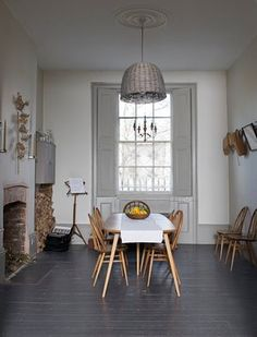Kristin Perers painted the floorboards in the vicarage's dining room black (Railings, farrow-ball.com).