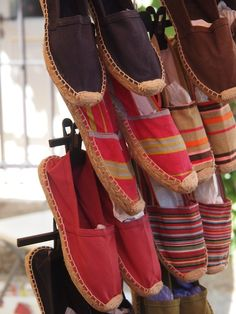 Espadrilles, marché provençal. (I'll take those middle reds ones with the yellow stripe!)