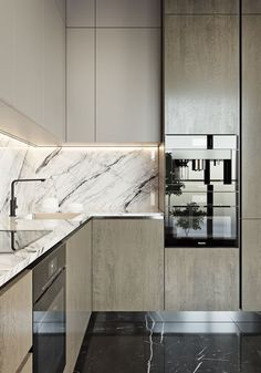 loving the marble backsplash of this modern kitchen with black marble floors
