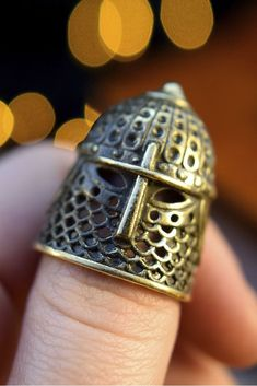 A thimble in the form of ancient Russian helmet made entirely of antiqued bronze with black patina. ⠀ Size: 3*2 cm ( 1,18*0,79 in ) ⠀ Helmet is a symbol of protection, strength, connection with mind and thought.