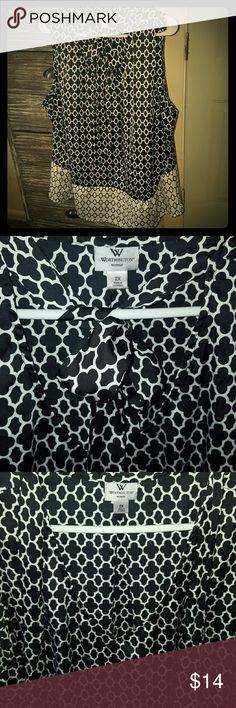 Black & White V Neck Top This shirt is by Worthington. It's a black and white silk feeling top. You can utilize the material for a bow front or you can leave it untied...either way, it's too cute to pass up!! Tops Blouses