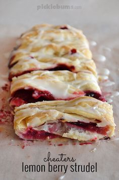 Uses only lemon butter, frozen pastry and berries. Icing is just lemon juice and icing sugar! Seriously good!