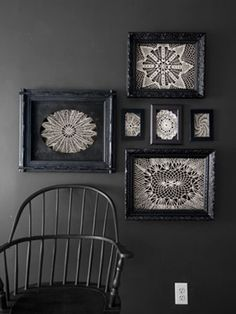 Just as Charlotte's webs attracted admirers, so too will these delicate displays. Using tape or tacks, secure vintage doilies to the open backs of black frames. The white crochet looks especially moody hung on a deep-hued wall. RELATED: 6 Poisonously Pretty DIY Halloween Decorations   - CountryLiving.com