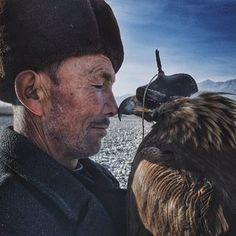 Grand prize winner and Photographer of the Year went to Siyuan Niu of China for his shot of a man and eagle