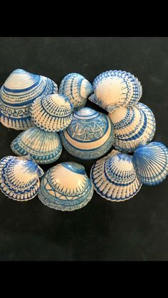 These hand-decorated shells look like Portuguese tiles. Done with Sharpie makers. Reminder of the Camino de Santiago de Compostela.