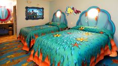 "2 double beds in a Little Mermaid-themed bedroom next to an alcove with a vanity - cheapest ""value"" room at Disney if all you need is a bed and a shower :)"