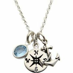 """Sterling silver necklace with a nautical-inspired charms and a blue Swarovski crystal accent.  Product: NecklaceConstruction Material: Silver and Swarovski crystalColor: Silver and blueDimensions: 18"""" Chain"""