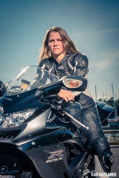 Photo by Kari Savolainen. Female biker portrait.