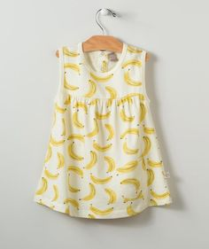 She'll go bananas for this fruity print dress! She'll be ready to spring into action at the playground, park or beach in style.  Your baby or toddler girl will love the pattern, and you'll love the water-based inks that stand up tough to any washing machine.