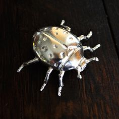 Ladybug 2 Ounce Hand cast Silver Collectible  Hand cast from Certified .999 Fine Silver This item is unique and limited in mintage.  Custom orders available! All pieces can be sold individually or as a set. You may also send your own template for castings as well.  Follow us on Instagram @barrelyliving and feel free to ask any questions!  *Barrely Living is a company based on high quality craftsmanship. All items are hand crafted and may vary in size, weight and color.