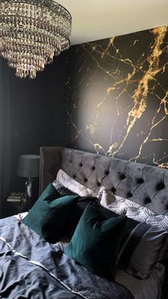 Get on the dark interior trend and be inspired by this customer's beautiful black bedroom! Featuring our Black and Gold marble wallpaper, it looks so luxurious in this decadent bedroom. Go all out with the dark accessories to create a cohesive space. Choose a dark grey or black bed and quilted headboard for in front of the mural. Style with charcoal bedding and emerald coloured cushions for a touch of colour. Have you been inspired? Get the look at Wallsauce.com! #bedroomdecor #darkinteriors