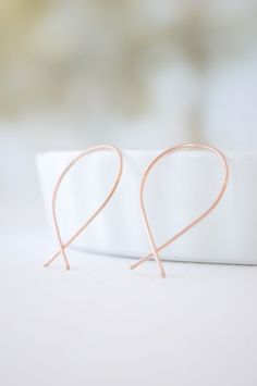 If classic hoops aren't your accessory of choice, try these inverted hoop earrings instead.