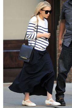 Ashley Olsen wears a loose striped sweater over a black maxi skirt. Click through for 50 more ways to style a striped shirt:
