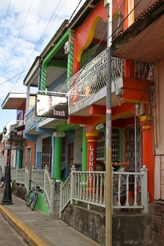Colorful colonial buildings in San Juan del Sur, Nicaragua - by Marion Robin