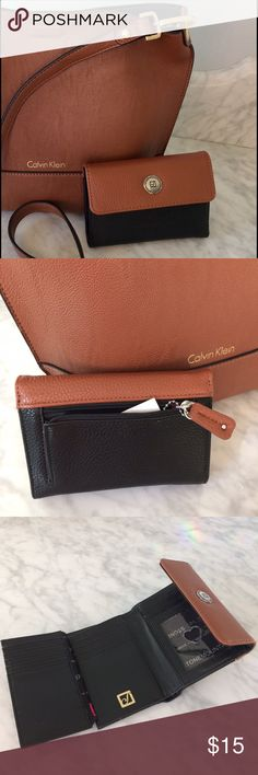 NWT Stone Mountain Tri-fold wallet This classy little tri-fold wallet packs a punch & is perfect for cross body bags! Why??? Because this little stinker has 16 credit card slots & it only measures 5.5 X 4 inches! It's new with tags. Retail price is $40. Bags Wallets