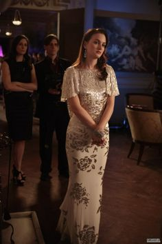 Elegant and a spectacular open back.    Marchesa gown.  Swarovski earrings.  Stella & Dot bracelet.