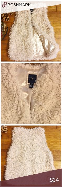 """NWT Gap Faux Fur Vest in Chalk Light Tan Color XS NWT Gap Factory Store Faux Fur Vest in Chalk Light Tan Color XS --- Faux fur is polyester --- Fully lined in polyester --- Side slit pockets --- One hook and eye closure --- 18"""" bust when closed --- 24"""" length --- thank you for visiting my boutique, please feel free to ask any questions  Gap Jackets & Coats Vests"""