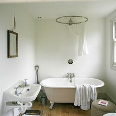 Bathroom idea. Different skin..and colors but Love the bath and shower head.