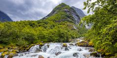 """Glacial River Flow - One of the rivers coming from """"Jostedalsbreen"""" glacier in Olden, Norway, surrounded by a lush valley."""
