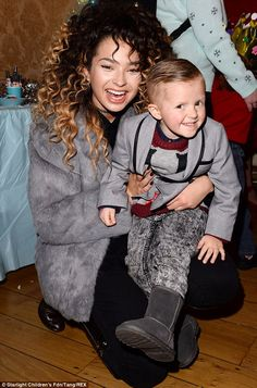Pop star cuddles: Ella Eyre cuddled up to one cheeky party guest who wore a charcoal blazer Ella Eyre, Geri Halliwell, Tori Kelly, Monochrome Outfit, Party Guests, Cuddles, Charcoal, Short Hair Styles, Hair Color