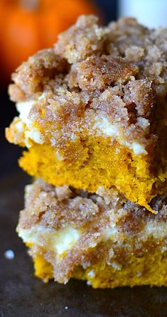 Cream Cheese Crumb Cake Soft, moist pumpkin coffee cake with a layer of cream cheese and a sugary, pumpkin spiced steusel!Soft, moist pumpkin coffee cake with a layer of cream cheese and a sugary, pumpkin spiced steusel! Köstliche Desserts, Delicious Desserts, Dessert Recipes, Yummy Food, Tasty, Health Desserts, Pumpkin Coffee Cakes, Pumpkin Dessert, Pumpkin Spice Cake