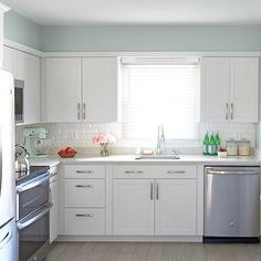 Lowes Arcadia Cabinets with  Soothing Blue Walls