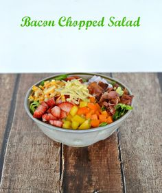 Bacon Chopped Salad has lettuce, tomatoes, peppers, bacon, and cheeses served with a side of homemade strawberry poppyseed dressing for an easy weekday supper. Healthy Eating Recipes, Healthy Cooking, Vegetable Recipes, Healthy Food, Salad Dressing Recipes, Salad Recipes, Salad Wraps, Chopped Salad, Food Dishes