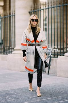 A blanket coat is on-point with a sleek belt and simple separates.