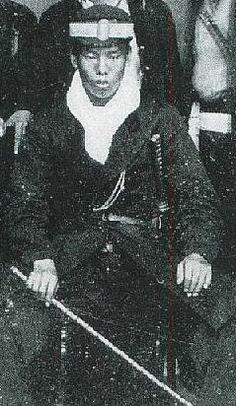 Samurai holding a muchi (whip), Boshin war era.