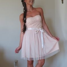 NWT- Crochet Tulle Dress in Blush Girly, romantic, and ethereal describes this strapless dress that would be perfect for bridesmaids. The Standing Out Dimensional Crochet Tulle Dress has a strapless sweetheart neckline and lightly padded bust. The top part is made of an embroidered mesh fabric with dimensional crochet flowers on it that stand out from the fabric. The attached skirt is fully lined and made of tulle. An included sash wraps around the waist and can be tied into a bow. A hidden…