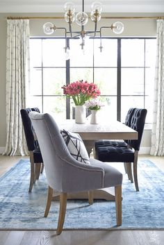 Transitional Modern Dining Room with brass accents and vintage inspired rug