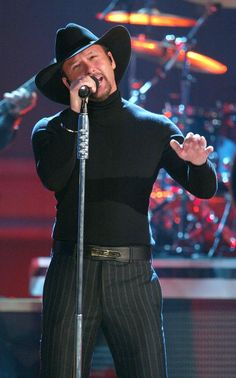 """Singer Tim McGraw performs onstage at the """"37th Annual CMA Awards"""" at the Grand Ole Opry House"""