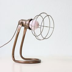 Industrial Caged Lamp. $ 38.00, from bellalulu on Etsy. - It's like a tiny retro fan mated with a broken lamp and had a cool industrial light fixture baby.