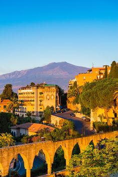 Top of Mount Etna Volcano at sunrise rising above Taormina, East Coast of Sicily