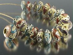 Beads made with CG bead roller - Donna Felkner #lampwork #beads