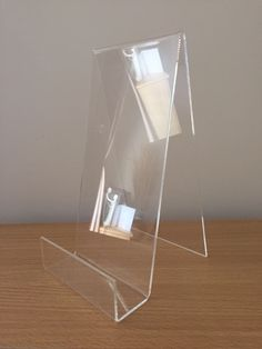 I bought an acrylic magazine/book stand to display my magazine for the exhibition. I think my choice of clear acrylic is the most contemporary and affordable choice. This cost me approximately £5 from Amazon.
