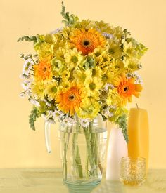 SUNBURST Mums, Gerbera & Snap Dragon Flowers This cheerful spray is bursting with yellow gerberas, mums and snapdragons. You can't deny that it sings joy and happiness that radiate from the heart. Joy And Happiness, Gerbera, Spring Flowers, Glass Vase, Dragon, Yellow, Heart, Dragons, Hearts