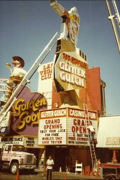 """Installation of the Glitter Gulch sign, Las Vegas, 1980 """"signs go up…and signs come down. We thank Vegas Vickie for the time she spent downtown, and we hope to see her again soon! Vegas Lights, Vintage Neon Signs, Las Vegas Photos, Cities, Retro Images, Old Signs, Retro Wallpaper, Las Vegas Nevada, Googie"""