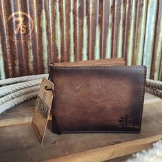 - Men's distressed rustic leather wallet - Rich quality leather - Two bill holder slots - Multiple card holders on each side - Mesh fabric ID holder - Super soft was an easy broke-in feel - By STS Ran