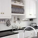 plate rack over sink. small shelves under wall cabinets