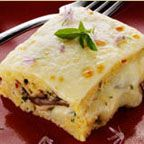 Baked Polenta with Provolone, Roasted Peppers and Mushroom - Delicious served as is, or with a marinara sauce or other complimentary-flavored sauce, this makes a wonderful meatless entree or hearty side dish.