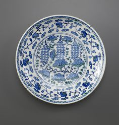 Dish with Grape Design late 16th century   Ottoman period  Stone-paste painted under colorless glaze H: 5.9 W: 32.5 cm Iznik, Turkey  F1970.25