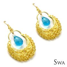 18k Gold plated delicate floral pattern filigree-like work earrings with a dazzling blue crystal drop. Great accents to pair up with your pretty sarees/ kurtis this Festive Season. Comes wrapped in a festive cloth case.