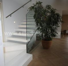 stone cantilevered stairs with glass and a turn