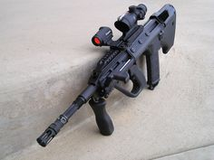 Steyr Aug with off set sights..have always really like the looks of the aug. way ahead of its time