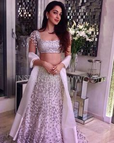 Hot Heroine Kiara Advani Long Hair Photos In White Lehenga Choli Indian Bridal Lehenga, Red Lehenga, Indian Gowns, Indian Attire, Indian Wear, Indian Style, Pakistani Dresses, Indian Wedding Outfits, Bridal Outfits