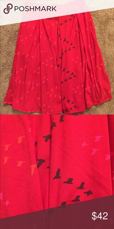 Lularoe Madison Medium Lularoe Madison Medium NWOT red background with birds. The Madison skirt ha pockets! Super comfy material! Never worn. LuLaRoe Skirts Midi